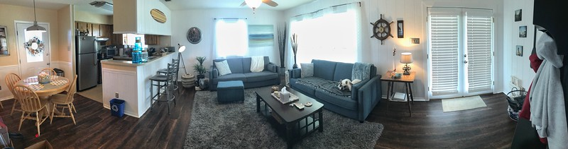 iPhone panoramic of the dining, kitchen, and living room.