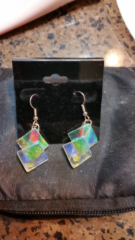 $20 earrings with color changing glass.   On black one color.   On white another (see next photo).... several pieces could be identical but different just because the way the colors play....
