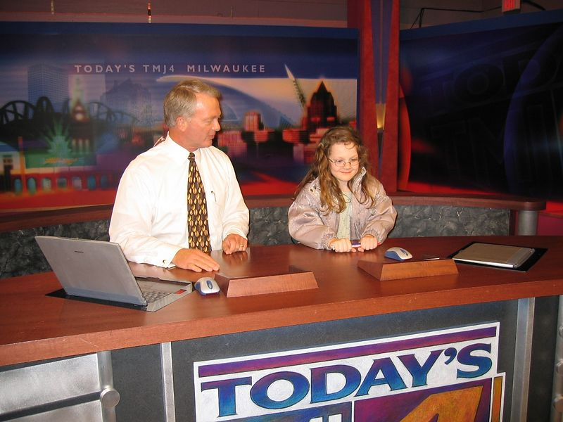 Rowan gets a tour of TMJ4 TV Station from Mike Jacobs, anchor who covered STS-107.  Here, Mike shows Rowan what it is like to sit at the anchor desk.  She was pretty thrilled.
