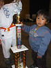 Riley - Hey, I shudda competed. This trophy is taller than me...
