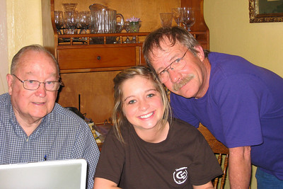 Grady and Mary Clare drove to Denison to visit with Bill and Myra in April - It's always a great excuse for dinner and a party! How many hours does it take to refine the family history? Grady, Caroline, and Russ reviewing old pictures Bill and Myra: Russ, Cheryl, and Caroline; Michael, Kelly, Kasen and Summer; Kelley, Chuck and Kane; Robert; David; Kathy; Shorty and Cheryl Giacomazzi
