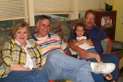 Grady and Mary Clare drove to Denison to visit with Bill and Myra in April - It's always a great excuse for dinner and a party! Cheryl, Shorty, Summer, and Russ resting on the couch Bill and Myra: Russ, Cheryl, and Caroline; Michael, Kelly, Kasen and Summer; Kelley, Chuck and Kane; Robert; David; Kathy; Shorty and Cheryl Giacomazzi