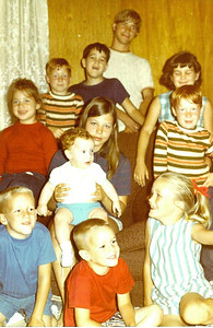 Christmas 1969, 125 East Arlo Drive, Harker Heights, Texas.  Top down - Russ, John, Michael, Kathy, Kelley, Cindy with Allen, Robert, Pat, Andy, and Betsy Kane.  Before John left to spend Christmas with John and Mayme Galligan.