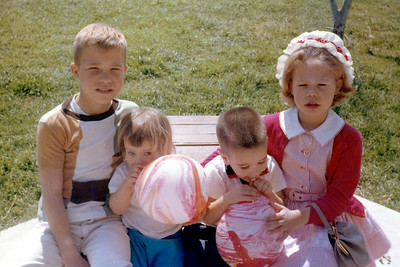 John and Kathy Kane blowing balloons with their cousins, Russ and Cindy, on Easter Day, March 29, 1964. Gray Drive, Killeen, Texas?