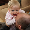 Daddy's doing something with his lips that tickles my tummy.....wow, Daddy, that tickles.
