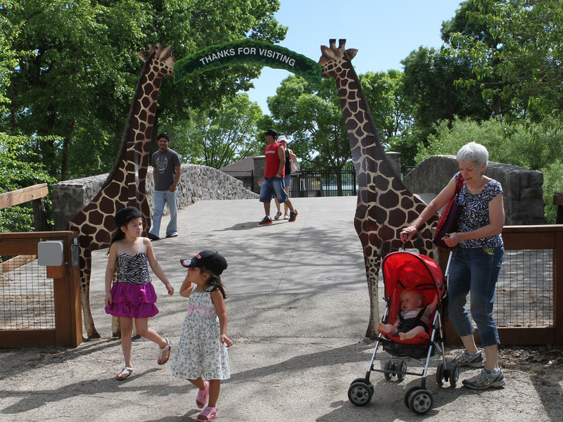 Thanks for visiting says the sign between two tall giraffes.  It's been a wonderful afternoon.