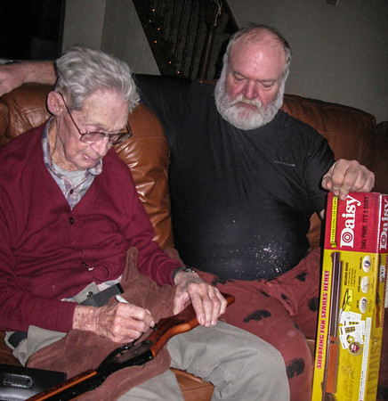 Grandpa-signs-Reids-first-gun-2