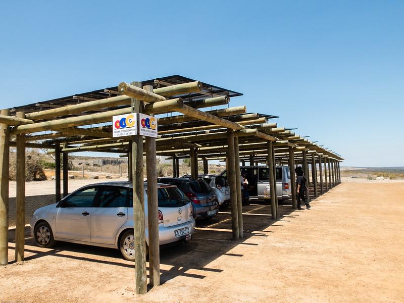 !Khwa ttu - photovoltaic panels used to shade parking