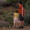 Gino and Sophia investigating the bush while waiting for the braai