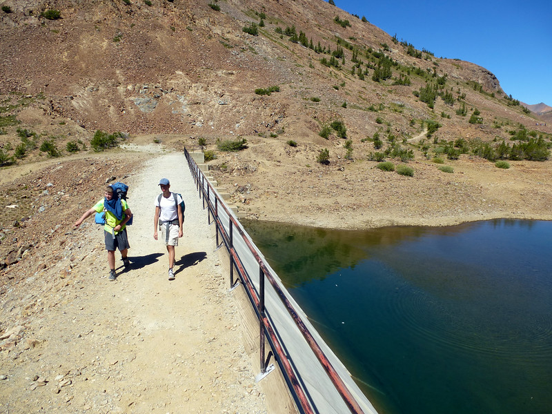 Elias and Alfred crossing the dam