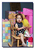 """On Her Throne""<br /> Sadie on her new rocking chair surrounded by her treasure!"