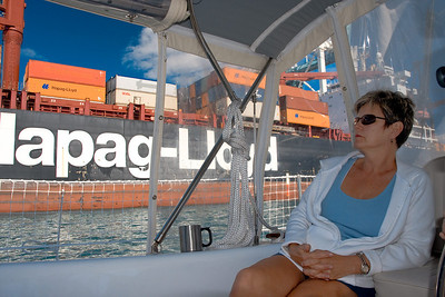 Charlotte looks at the Hapag-Lloyd container ship while we motor through the Port of Miami.