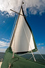 "The top of this green mainsail ""catcher"" unzips for efficient hoisting and lowering of the mainsail."