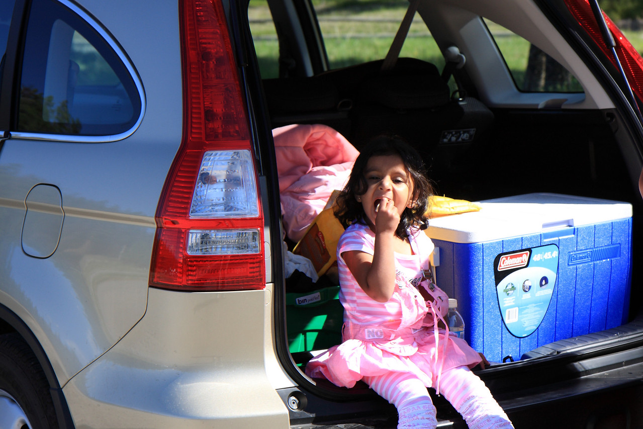 Sakshi enjoying snacks in car trunk at Maligne Canyon Parking