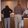 Father and daughter hard a work on something