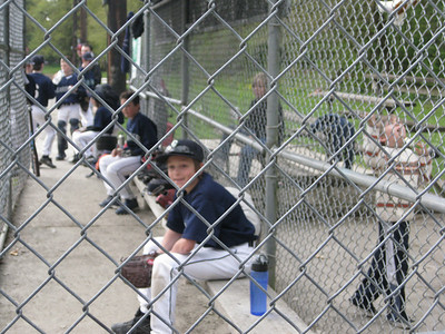 Sam in the dugout (and Lucas on the right).