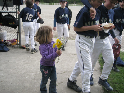 Sam and his friend after the game, Carly giving flowers.