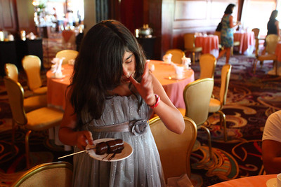Jumanah liked dipping stuff in the chocolate fountain.