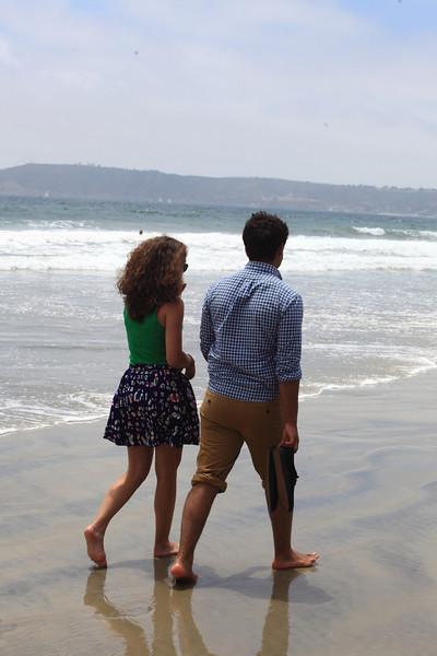 The cousins walking along the beach.