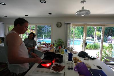 Matthew making breakfast in Sabiha's kitchen.