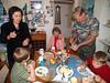 Everybody enjoying preparing and eating.