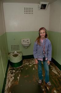 Sara, in an Alcatraz cell