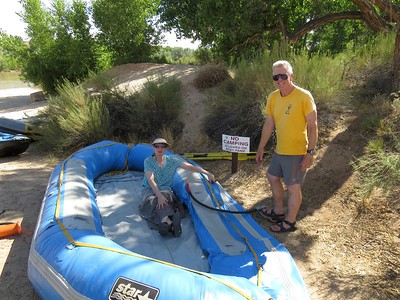 Rena and Craig are pumping up the big raft. It would have been nice to have a pump that runs off a car battery.