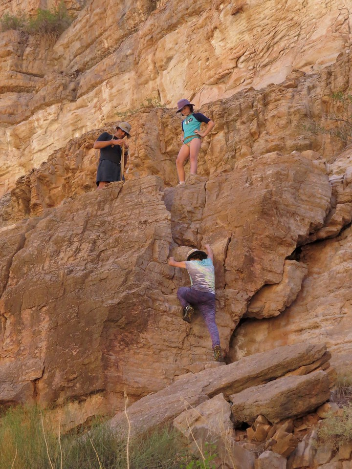 There is a 12-foot Class 3 scramble to get to the upper ledge. Marla makes short work of it. We used the bowlines from the raft to belay Sophie and Alex.