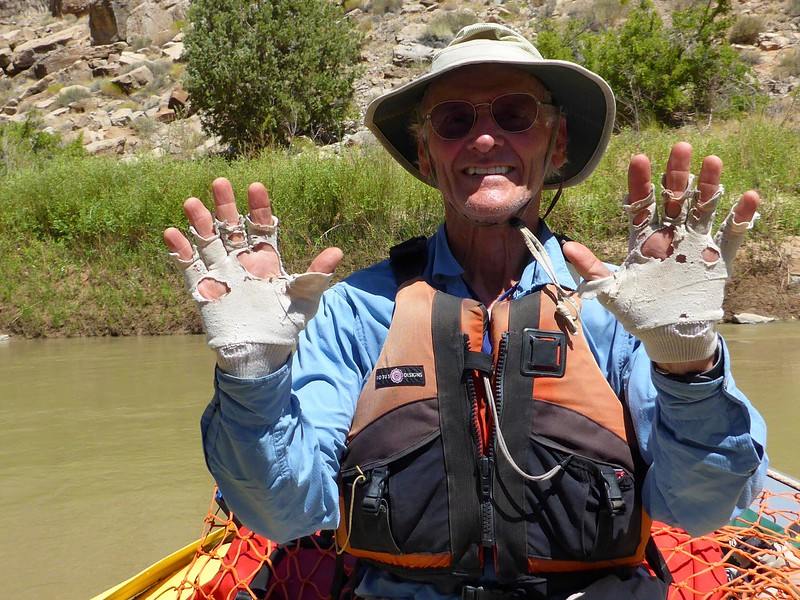 I have been using these old white ski gloves for sun protection for many years. My friends kept taking bets on when they will finally disintegrate. Not *this* trip!<br /> Photo by Rena Tishman.