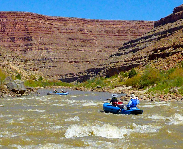Craig usually rowed the big raft but the rest of us switched around often. Here Marla and Alex are navigating a small ripple.<br /> Photo by Rena Tishman.