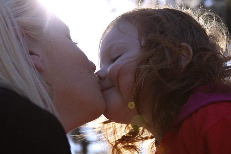 Kristin and Josie kissing at Kasey's graduation, MCRD Parris Island, SC. (Photo by Sandy Pomeroy)