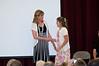 The principal congratulating Kelsey