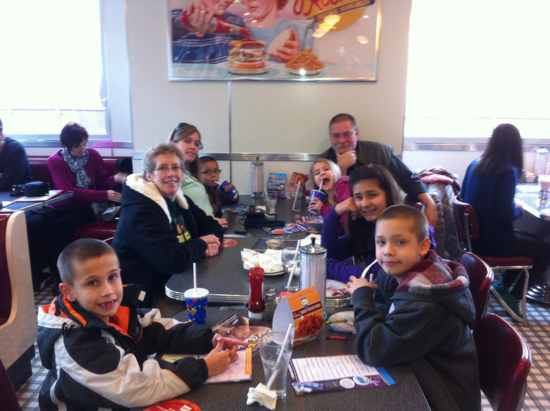 Everybody at lunch at Johnny Rocket's. Clockwise: Hunter (8,) Jann, Sarah, Frankie (5,) Mark's dad, Tiffany (6,) Victoria (12,) Zao (9)