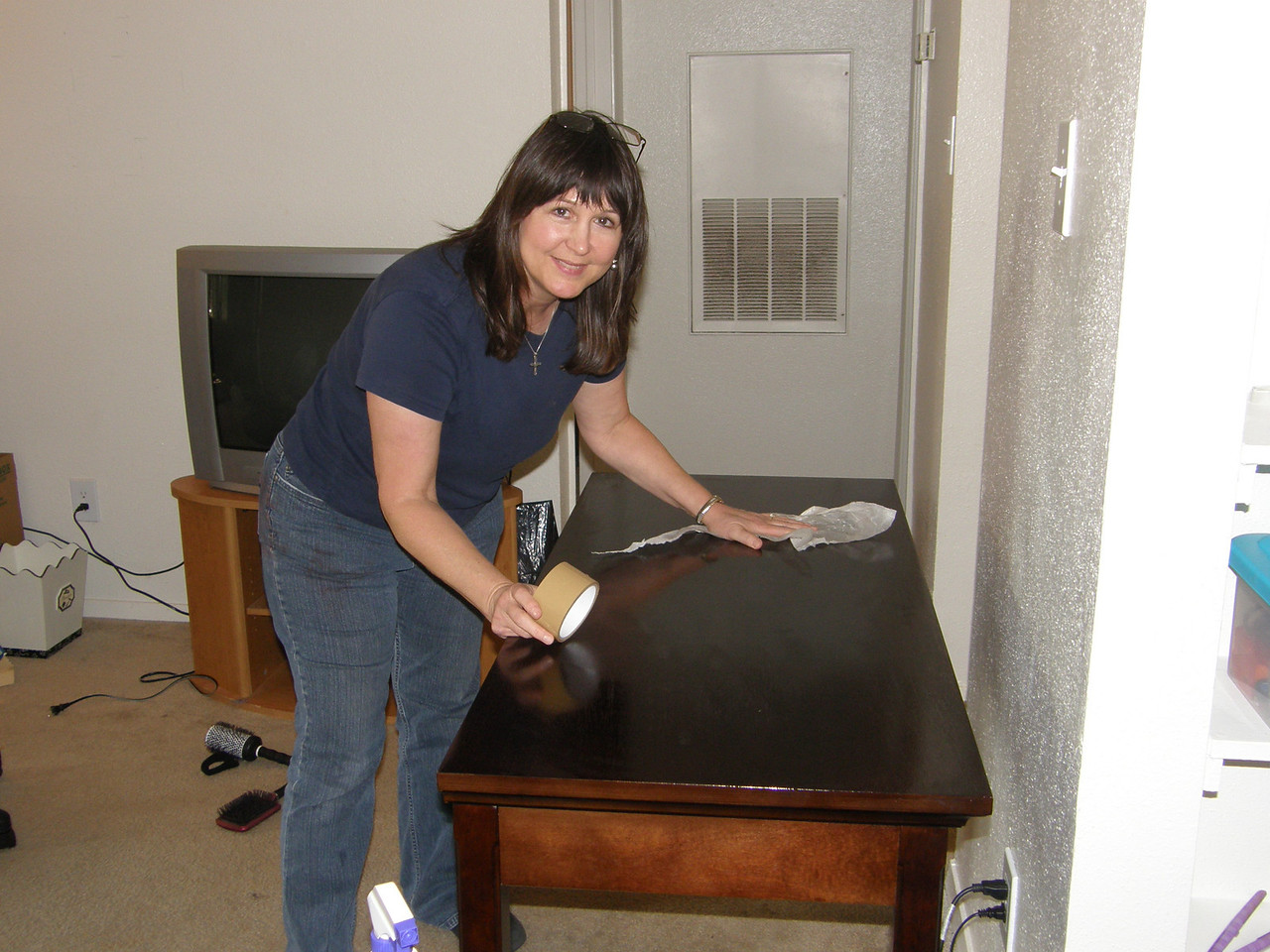 Mary Jane is still polishing that table.  Look at it shine!  Awesome.