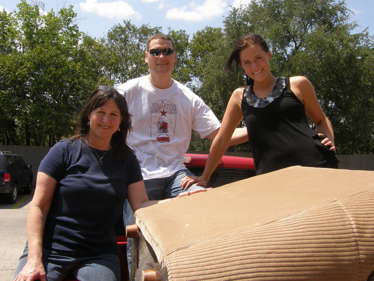 Mary Jane (Sarah's mom) , Adam and Sarah enjoying standing in the pickup bed.