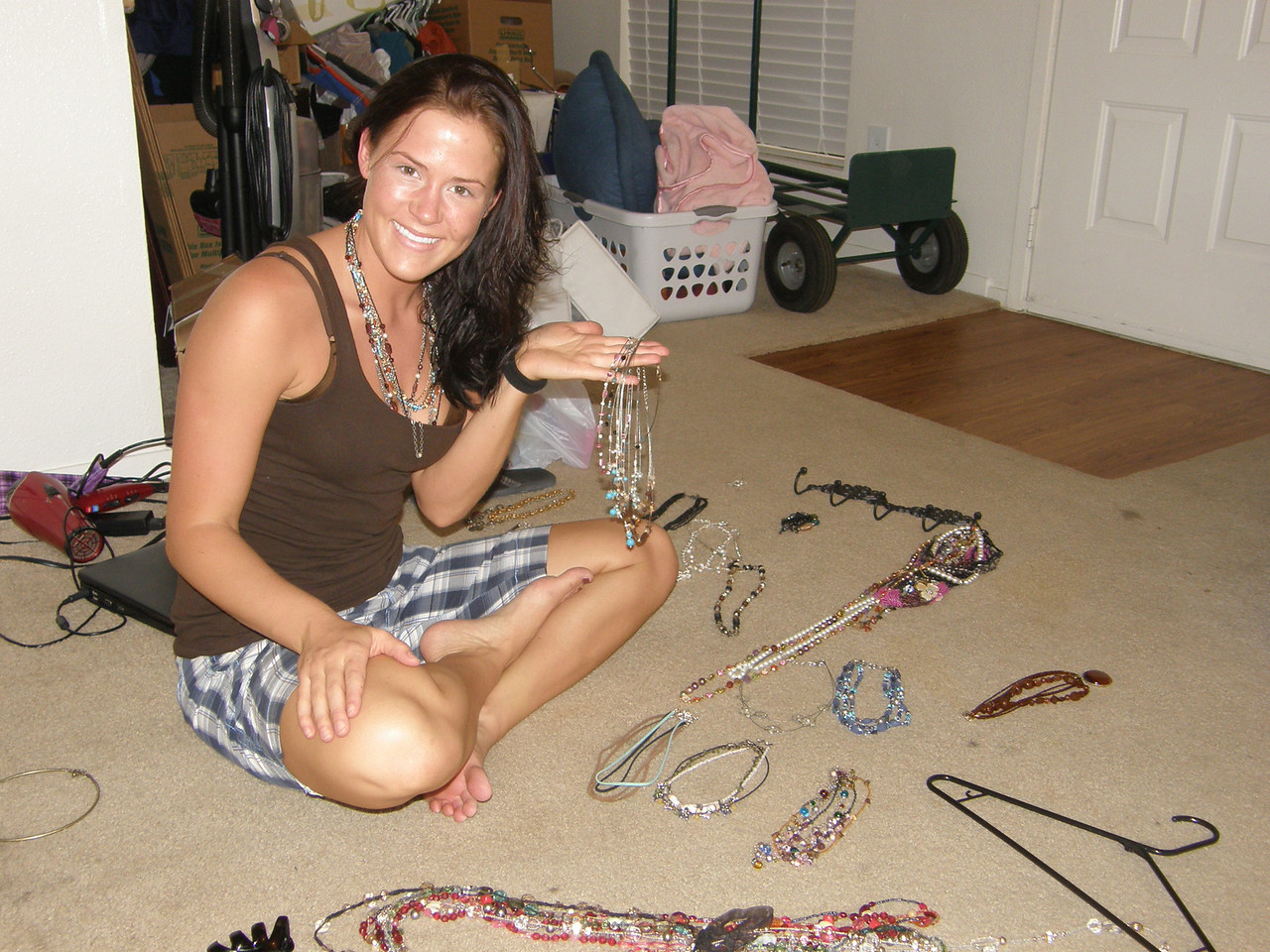 Sarah poses with some of her jewelry!   This is the advantage of having a mom who markets jewelry!  Neat.
