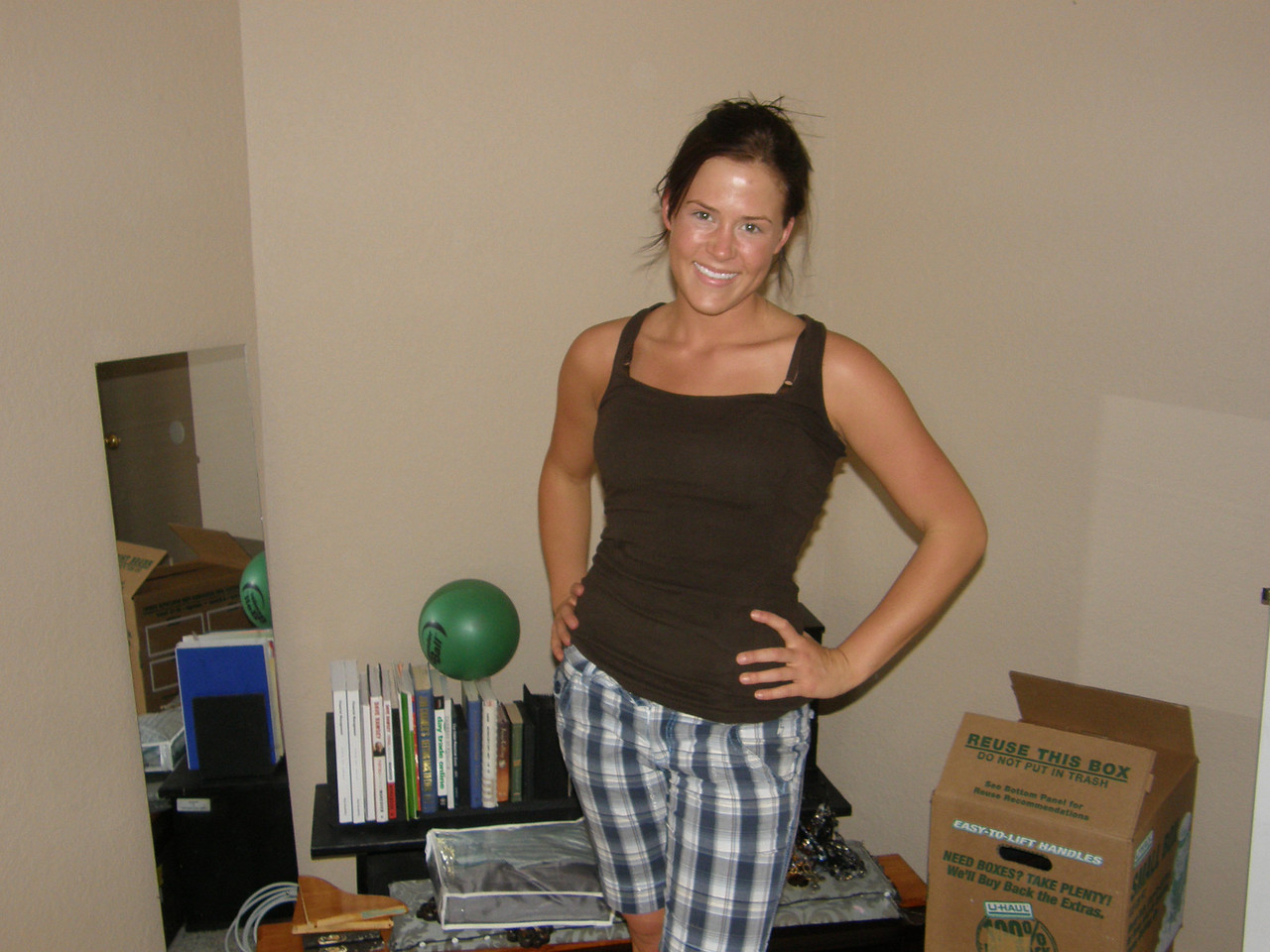 Sarah Jane posing in front of some of her stuff.   Sarah's not sweating is she?