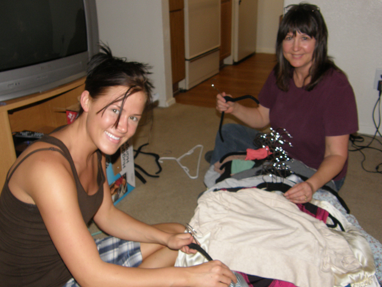 Sarah and mom working on some clothes.