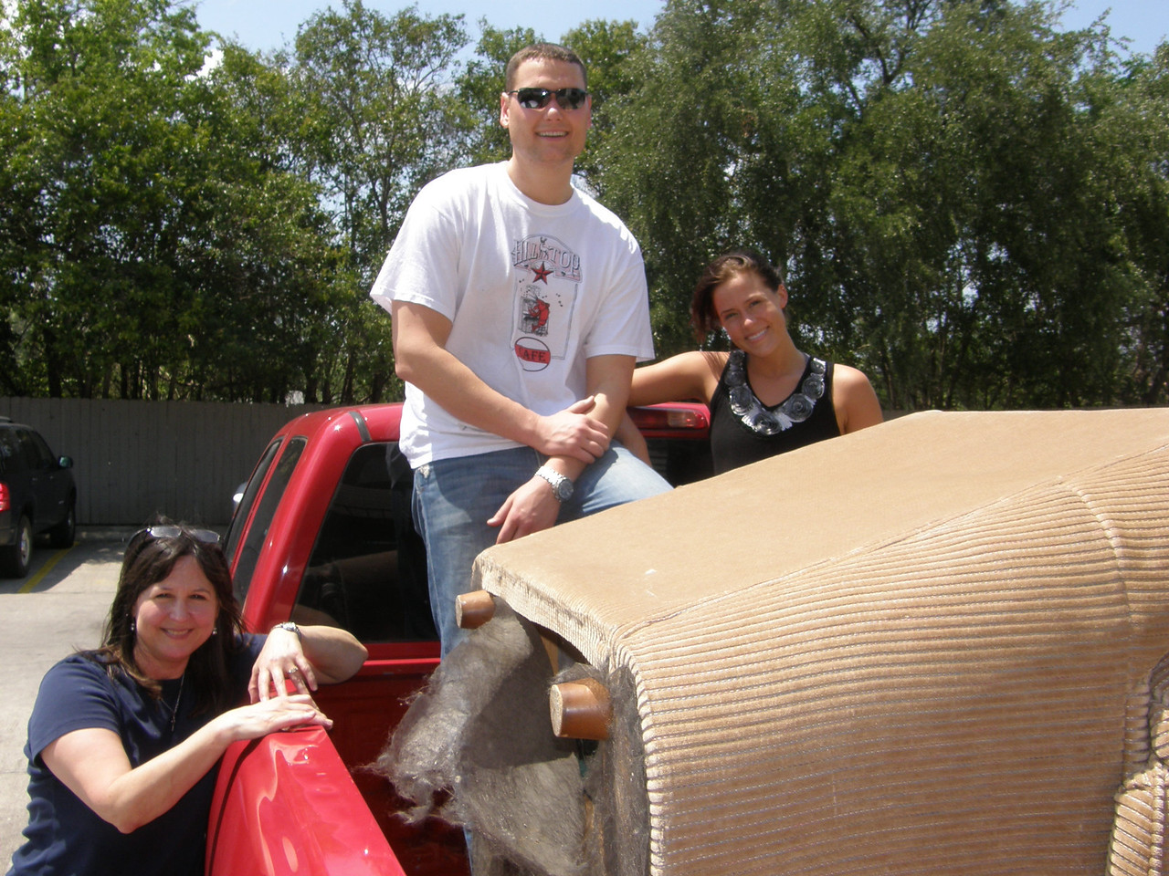 Mary Jane, Adam, and Sarah have the pickup filled and ready to go.