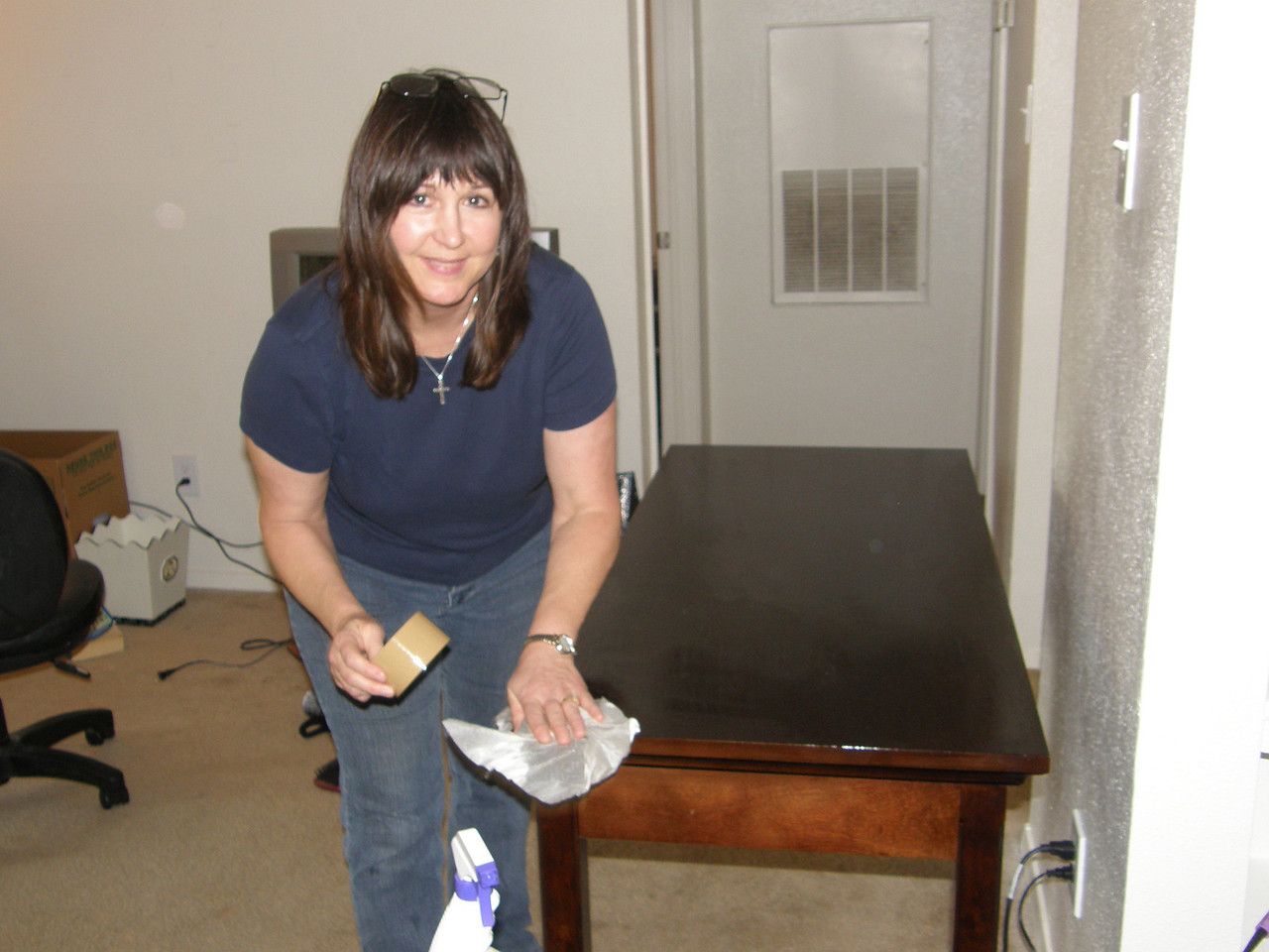 Mary Jane polishing up the furniture before Sarah leaves her old apartment.