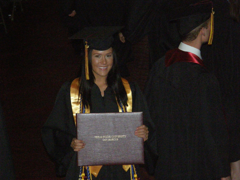 This I think is a great picture of Sarah standing in front of crowd holding up her diploma.  Great job Sarah!  Lot's of hard work to get this.  Suma cum laude, in a very difficult major.