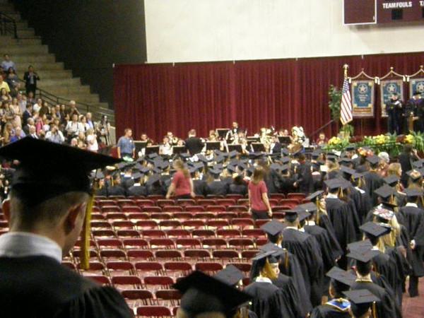 Graduates filing into rows.