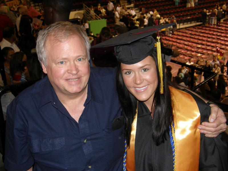 Dad and Sarah rejoice after the graduation!