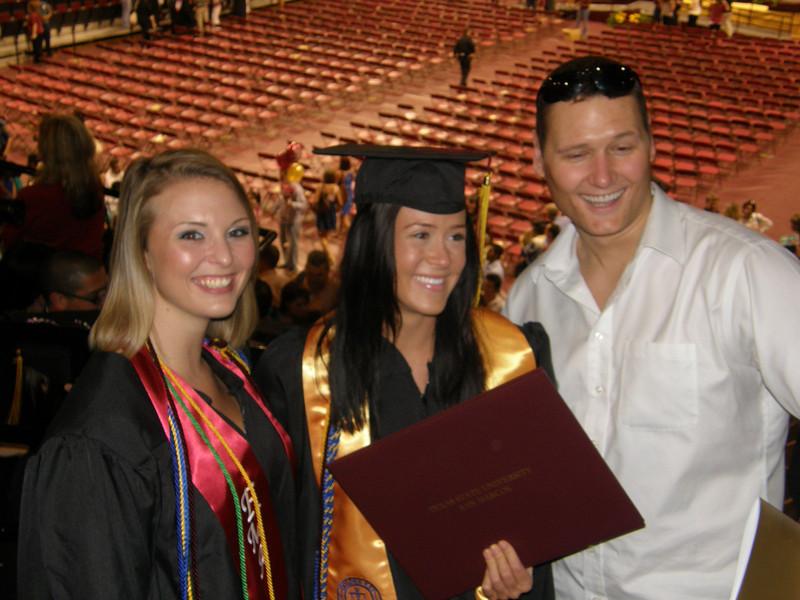 Kristina, Sarah, and Adam all rejoice after ceremony.