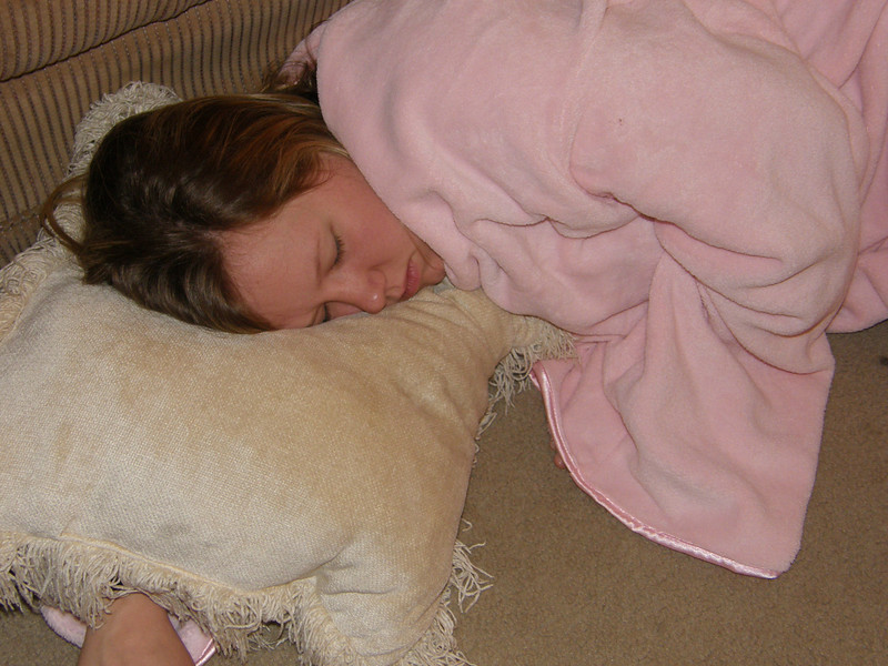 Katie taking a snooze in Sarah Jane's apartment before graduation.