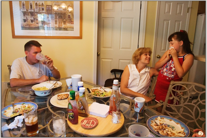 "First real meal at the McCarthy's new house.<br /> <br /> Howard, Sara and Mary Catherine here.  It was chicken, Salad, rice and Cheese cake, excellent!<br /> <br /> We all enjoyed the good food, conversation and ""family feeling""."