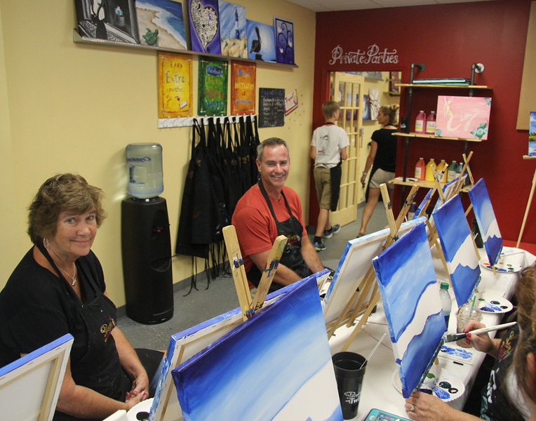 a family painting lesson