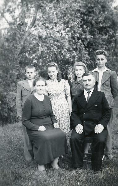 Mary Shupshinskas, seated, and her family