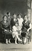 From left to right:   Standing: Mary Evaskitis, Unknown boy, Agnes Evaskitis.   Seated: Veronica Shupshinskas, Aniele Evaskitis, Magdalena Shupskinskas.   Standing in front: John Puzauskas
