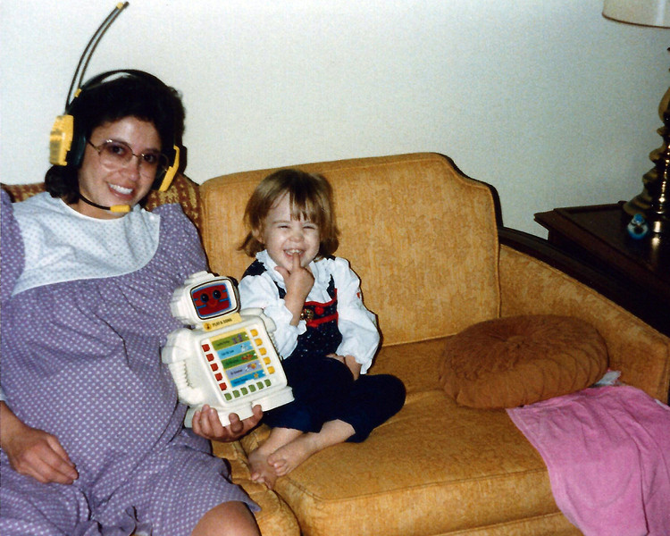 Emmie with her early cellphone and droid